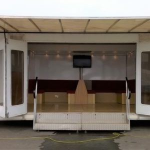 Exhibition Unit, 23ft X 7ft main body with extendable rear section and awning, comes complete with electric hook up internal lighting , TV & Dvd player,  kitchen area with urn and sink, 