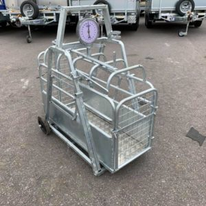 """FOR SALE. Galvanized Lamb weigh bridge ,heavy duty 200/250kg weigh clock as standard to ensure perfect long term weighing under any condition. It has a non slip floor, with front and back gates which are all operated from the back • Cage length 42""""• Overall length 45″ for further information Call Mark on 07710637078 or  Sam on 07522716854"""
