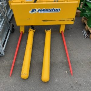 Johnston Bale Handler .Comes complete with hydraulic ram, Rolling Detachable rollers with grease nipples,  Bale spikes 1200mm, Matbro cone and pin attachment. For further information contact Sam on 07522716854 Or Mark on 07710637078